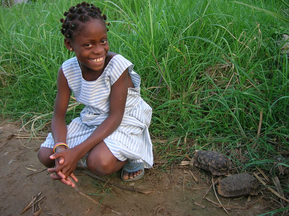 Young girl with a Home's Hingeback in Benin