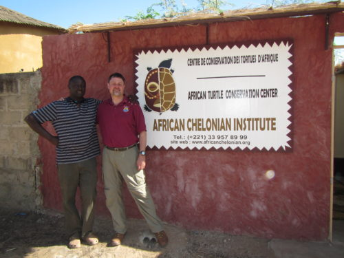 Tomas Diagne (ACI Director) with Thomas Leuterlitz (USFWS-CITES) next to the entrance sign of the Rhodin Center-Ngaparou-Senegal